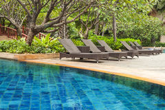 Poolside loungers. At an exotic asian hotel Royalty Free Stock Photo
