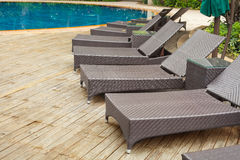 Poolside loungers Stock Images