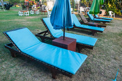 Poolside loungers Stock Photos