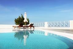 Poolside. Luxurious patio water pool Stock Photos