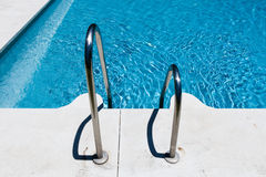 Poolside metal steps Stock Image