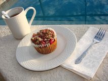 Poolside muffin and coffee. Poolside breakfast of cranberry muffins and coffee Stock Photo