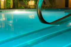 Poolside night. Calm and empty poolside at night Stock Image