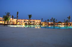 Poolside By Night. A poolside shot at night at a resort in Sharm El Shiekh Royalty Free Stock Photo