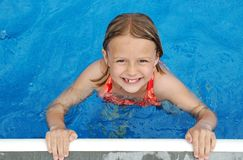 Poolside Smile. Girl smiling at pool side Royalty Free Stock Photography