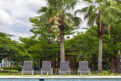 Poolside sunbeds Stock Photo