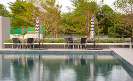 Poolside tables and chairs Royalty Free Stock Image