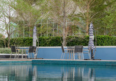 Poolside tables and chairs Stock Images