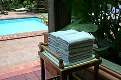 Poolside towels. Towels next to the pool in a tropical resort Stock Images