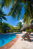 Poolside at a Tropical resort Royalty Free Stock Photography