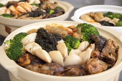 Poon Choi Cantonese Big Feast Bowls Closeup. Poon Choi Hong Kong Cantonese Cuisine Big Feast Bowls with Seafood and Vegetables for Chinese New Year Dinner Royalty Free Stock Photography