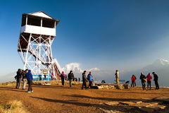 Poon hill with tourists and mount Dhaulagiri. POON HILL, NEPAL, 8th APRIL 2016 - morning view of Poon hill with tourists and panoramic view of mount Dhaulagiri stock image