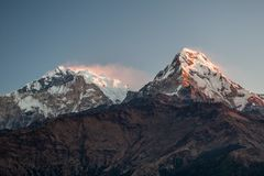 Poonhill view of Annapurnas. Warm pink and orange sunrise light over Annapurna mountain range from Poon hill, Himalayas, Nepal stock image