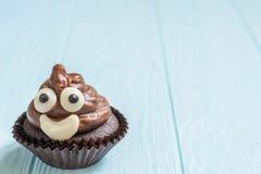 Poop emoji cupcakes. Funny poop emoji chocolate cupcakes. Cute food dessert stock photography