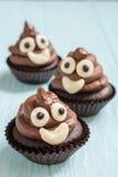 Poop emoji cupcakes. Funny poop emoji chocolate cupcakes. Cute food dessert royalty free stock photo