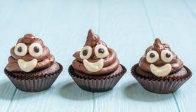 Poop emoji cupcakes. Funny poop emoji chocolate cupcakes. Cute food dessert royalty free stock images