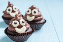 Poop emoji cupcakes. Funny poop emoji chocolate cupcakes. Cute food dessert royalty free stock photos