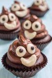 Poop emoji cupcakes. Funny poop emoji chocolate cupcakes. Cute food dessert stock photos