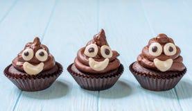 Poop emoji cupcakes stock images