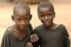 Poor African boys smiling stock photography