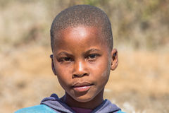 Poor african child. Portrait of a poor South African child on the road leading to UMkhuze Game Reserve, South Africa Stock Photo