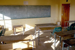 Poor african classroom with empty desks. Empty classroom in poor african rural school royalty free stock images