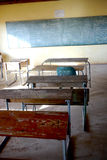 Poor african classroom with empty desks. Empty classroom in poor african rural school royalty free stock photos
