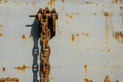 Poor of Anchor chain. Anchor chain for floating dock it's very poor condition and very rusty hanging on side wall of floating dock stock images