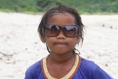 Poor asian girl wearing sun glasses Stock Image