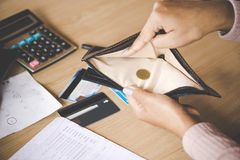 Free Poor Asian Woman Hand Open Empty Purse With Only One Coin Stock Images - 119666654