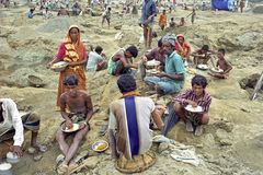 Poor Bangladeshi family working in gravel pit. Bangladesh, Tangail city: Bengali women, men and boys from an extended family working together in pebble or gravel Royalty Free Stock Photos