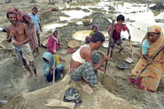 Poor Bangladeshi family working together in gravel pit Royalty Free Stock Photo