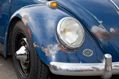 Poor beetle. The front of an old and rusty car accident royalty free stock photography