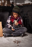 Poor beggar child boy reviews the money he received royalty free stock images