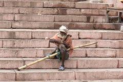 Poor beggar in Varanasi. Old bagger in Varanasi, India Royalty Free Stock Image