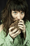 Poor beggar woman eating bread Royalty Free Stock Photos