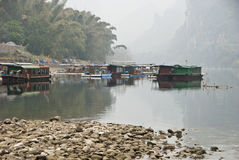 Poor Boat Houses along Li River, Guilin, China. Boat Houses along Li River stock photo