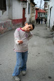 Poor boy at doorstep Stock Photos