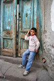 Poor boy at doorstep Stock Images
