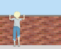 Poor Boy Looking Over Brick Wall Stock Images