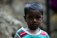 Poor Boy. A portrait of a poor boy from India in his unfortunate condition Royalty Free Stock Image