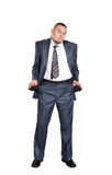 Poor businessman with empty pockets Stock Photo