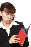Poor businesswoman Stock Images