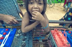 Poor cambodian kid playing Royalty Free Stock Photography