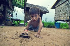 Poor cambodian kid playing Royalty Free Stock Photo