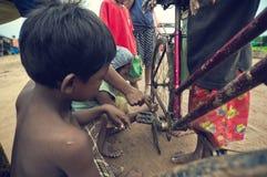 Poor cambodian kids working Stock Image