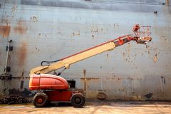 Poor cherry picker. Cherry picker in poor condition orange color look form side view royalty free stock photos