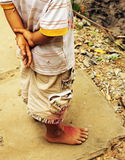 A poor child. Standing Vietnamese Stock Images