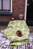 Poor children. Two poor children under a blanket in the street during the Charles Dickens festival in the city centre of Deventer, the Netherlands. This festival royalty free stock photos