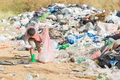 Poor children collect garbage for sale because of poverty, Junk. Recycle, Child labor, Poverty concept, World Environment Day stock images